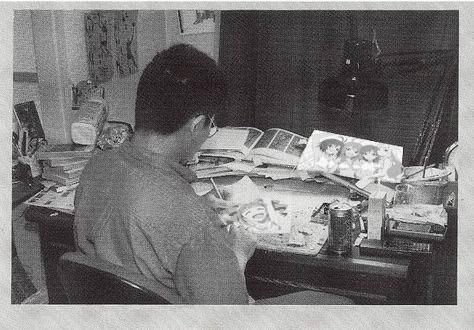 Kentaro Miura at his desk